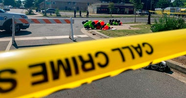 Police tape is seen near the scene of a shooting early Monday, June 22, 2020 in Charlotte, North Carolina, that resulted in two deaths and several more people wounded or injured.