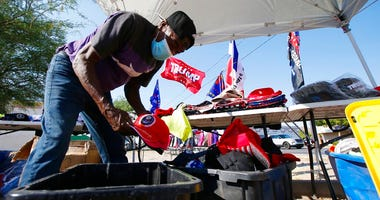 Mike Jackson sets up his concession area across from Dream City Church on Monday, June 22, 2020, in Phoenix. The church will host the Students for Trump convention, and a scheduled visit from President Donald Trump on Tuesday afternoon