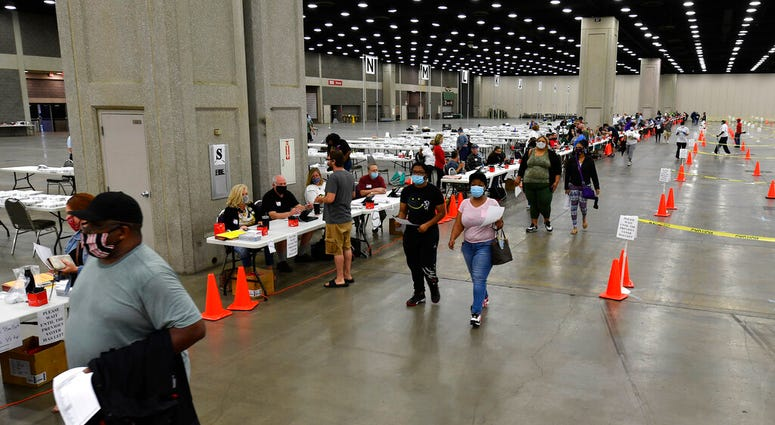 Voters head to the designated area to fill out their ballots in the kentucky primary at the Kentucky Exposition Center in Louisville, Ky., Tuesday, June 23, 2020.