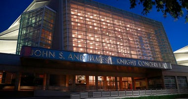 FILE- In this June 21, 2019 file photo, the Knight Concert Hall at the Adrienne Arsht Center for the Performing Arts of Miami-Dade County is lit up before dusk in Miami. (AP Photo/Wilfredo Lee, File)
