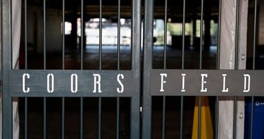 The main gate of Coors Field, home of the Major League Baseball team the Colorado Rockies, is locked early Tuesday, June 23, 2020, in Denver.