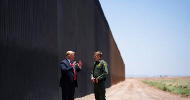 United State Border Patrol chief Rodney Scott gives President Donald Trump a tour of a section of the border wall, Tuesday, June 23, 2020, in San Luis, Ariz.