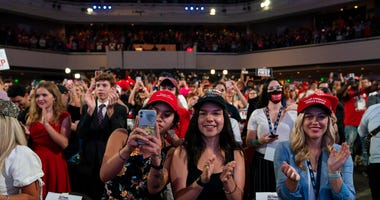 Supporters of President Donald Trump cheer as he arrives to a group of young Republicans at Dream City Church, Tuesday, June 23, 2020, in Phoenix.