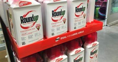 FILE - In this, Feb. 24, 2019, file photo, containers of Roundup are displayed at a store in San Francisco.