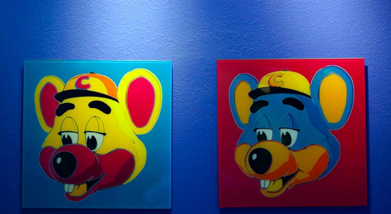 FILE - This Jan. 16, 2014 file photo shows paintings hanging on a wall at Chuck E. Cheese's in Dallas.