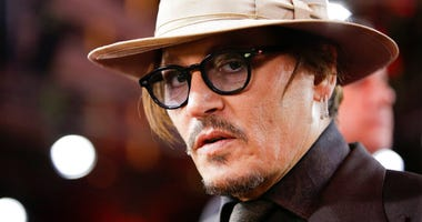FILE - In this Friday, Feb. 21, 2020 file photo, actor Johnny Depp arrives for the screening of the film Minamata during the 70th International Film Festival Berlin, Berlinale in Berlin, Germany.
