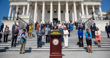 House Speaker Nancy Pelosi of Calif., joined by House Democrats spaced for social distancing, speaks during a news conference on the House East Front Steps on Capitol Hill in Washington, Thursday, June 25, 2020, ahead of the House vote on the George Floyd
