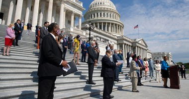 Rep. Karen Bass, D-Calif., joined by House Speaker Nancy Pelosi of Calif., and other House Democrats spaced for social distancing, speaks during a news conference on the House East Front Steps on Capitol Hill in Washington, Thursday, June 25, 2020, ahead