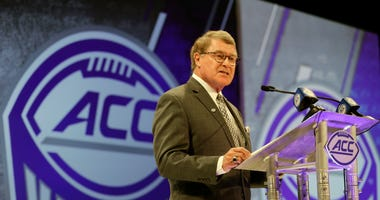 FILE - In this July 18, 2018, file photo, Atlantic Coast Conference commissioner John Swofford speaks during a news conference at the ACC NCAA college football media day in Charlotte, N.C.