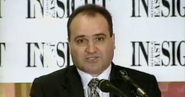 FILE - This 1998 file frame from video provided by C-SPAN shows George Nader, then-president and editor of Middle East Insight. Nader, a businessman who was a key witness in special counsel Robert Mueller's report and who helped broker the release of Amer
