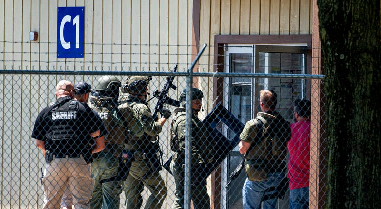 Law enforcement enter the C1 building to the west of the Bunn-O-Matic warehouse during an active shooter situation, Friday, June 26, 2020, in Springfield, Ill.