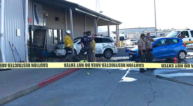 eputies and firefighters stand outside the Red Bluff Walmart distribution center after a man reportedly opened fire there and rammed his vehicle into the building, Saturday, June 27, 2020, in Red Bluff, Calif.