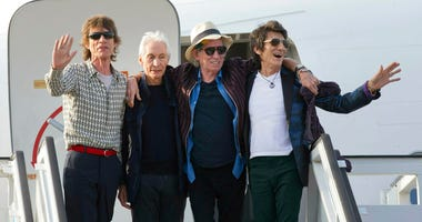 FILE - In this March 24, 2016 file photo, members of The Rolling Stones, from left, Mick Jagger, Charlie Watts, Keith Richards and Ron Wood pose for photos from their plane at Jose Marti international airport in Havana, Cuba.
