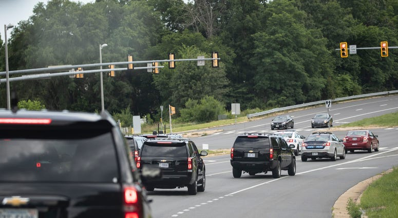The motorcade for President Donald Trump travels en route to Trump National Golf Club, Sunday, June 28, 2020, in Sterling, Va.
