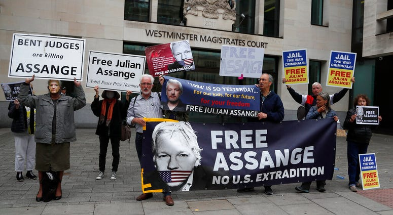 Supporters of WikiLeaks founder Julian Assange protest in front of Westminster Magistrates' Court in London, Monday, June 29, 2020, where he is expected to appear in custody for the extradition case management hearing.