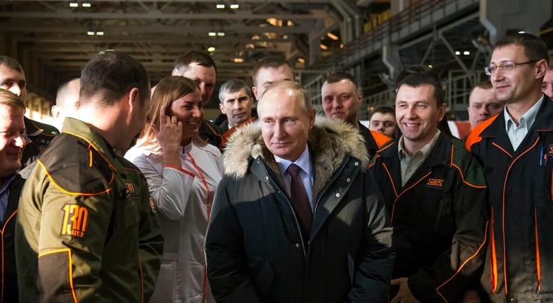 FILE - In this March 6, 2018, file photo, Russian President Vladimir Putin listens to employees of Uralvagonzavod factory in Nizhny Tagil, Russia.