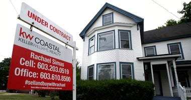 """FILE - In this June 20, 2018, file photo, an """"Under Contract"""" sign is displayed in front of home for sale in Raymond, N.H."""
