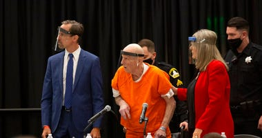 Joseph James DeAngelo, center, charged with being the Golden State Killer, his helped up by his attorney, Diane Howard, as Sacramento Superior Court Judge Michael Bowman enters the courtroom in Sacramento, Calif. Monday June 29, 2020.