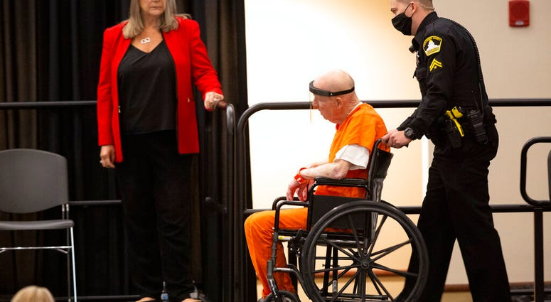 Joseph James DeAngelo, charged with being the Golden State Killer, is wheeled into the courtroom as his attorney, public defender Diane Howard, left, looks on in Sacramento, Calif., Monday June 29, 2020.
