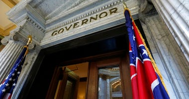 The Mississippi state flag is shown across from the American flag, outside the Governor's Office at the Capitol in Jackson, Miss., Monday, June 29, 2020, the day after both chambers of the state Legislature passed a bill to take down and replace the curre