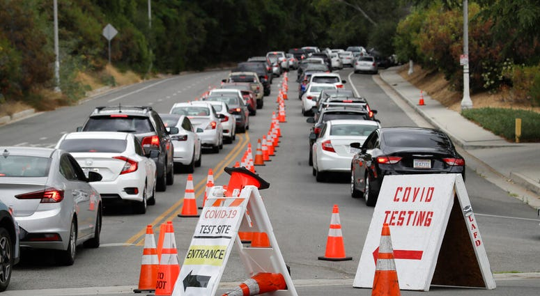 Motorists line up at a coronavirus testing site at Dodger Stadium Monday, June 29, 2020, in Los Angeles.