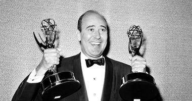"""FILE - In this May 26, 1963 file photo, Carl Reiner shows holds two Emmy statuettes presented to him as best comedy writer for the """"Dick Van Dyke Show,"""" during the annual Emmy Awards presentation in Los Angeles.  (AP Photo, File)"""