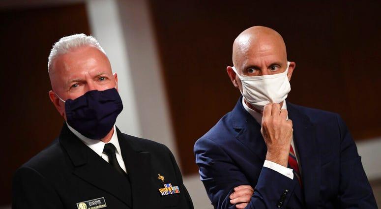 Adm. Brett Giroir, left, director of the U.S. coronavirus diagnostic testing, and Food and Drug Administration (FDA) Commissioner Stephen Hahn. (Kevin Dietsch/Pool via AP)