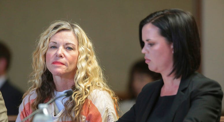 FILE - In this March 6, 2020, file photo, Lori Vallow Daybell glances at the camera during her hearing, with her defense attorney, Edwina Elcox, right, in Rexburg, Idaho.