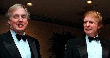 FILE - In this Nov. 3, 1999 file photo, Robert Trump, left, joins real estate developer and presidential hopeful Donald Trump at an event in New York.