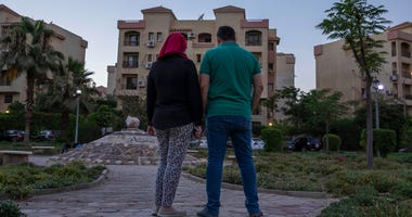 Noha, an Egyptian engineer, and her husband Ahmed, who were chosen to be among the U.S. government's roughly 50,000 visa lottery winners this year, pose for a photograph near their home in Cairo, Egypt, Tuesday, June 30, 2020.