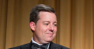 FILE - In this April 27, 2013, file photo, Ed Henry, Chief White House Correspondent for Fox News, applauds during the White House Correspondents' Association Dinner in Washington. (AP Photo/Carolyn Kaster, File)