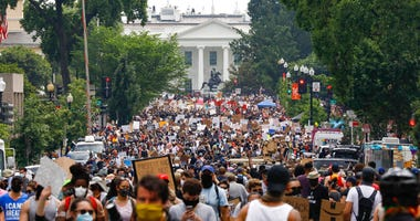 FILE - In this Saturday, June 6, 2020 file photo, demonstrators gather near the White House in Washington, to protest the death of George Floyd.(AP Photo/Jacquelyn Martin)