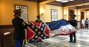 Honor guard members from the Mississippi National Guard practice folding the former Mississippi flag before a ceremony to retire the banner on Wednesday, July 1, 2020, inside the state Capitol in Jackson.