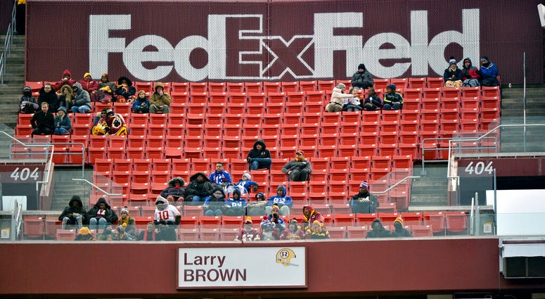FILE - In this Dec. 9, 2018, file photo, FedEx Field is less than full during the second half of an NFL football game between the Washington Redskins and the New York Giants in Landover, Md.
