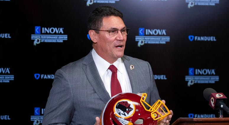 FILE - In this Jan. 2, 2020, file photo, Washington Redskins head coach Ron Rivera holds up a helmet during a news conference at the team's NFL football training facility in Ashburn, Va.