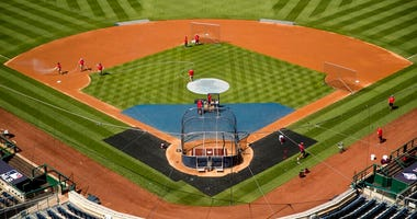 """A heart is visible in center field with the letters """"DC"""" as the Washington Nationals hold their first baseball training camp work out at Nationals Stadium, Friday, July 3, 2020, in Washington."""
