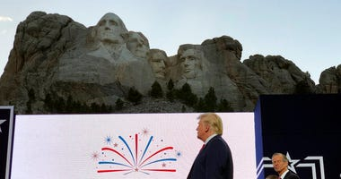 President Donald Trump stands on stage before he speaks at the Mount Rushmore National Monument Friday, July 3, 2020, in Keystone, S.D.