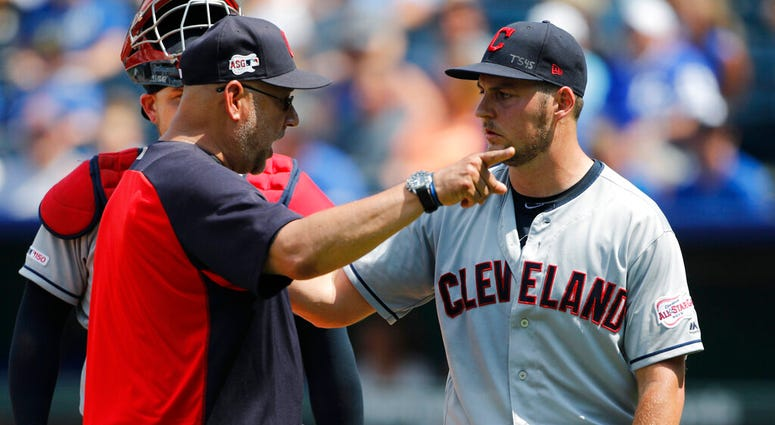 FILE - In a Sunday, July 28, 2019 file photo, Cleveland Indians manager Terry Francona, left, has words with pitcherTrevor Bauer, right, as Bauer is taken out in the fifth inning of a baseball game against the Kansas City Royals at Kauffman Stadium in Kan