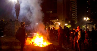 Twice on July Fourth, police declared a riot in downtown Portland, Ore., July 4, 2020.