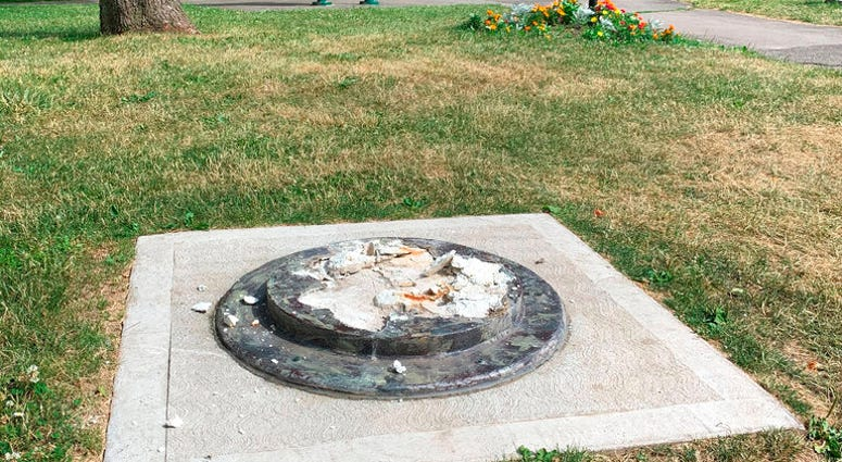 This photo provided by WROC-TV shows the remnants of a Frederick Douglass statue ripped from its base at a park in Rochester, N.Y., Sunday, July 5, 2020.