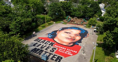 A ground mural depicting a portrait of Breonna Taylor is seen at Chambers Park, Monday, July 6, 2020, in Annapolis, Md.