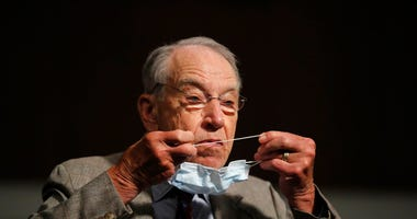 FILE - In this June 11, 2020, file photo, Sen. Chuck Grassley, R-Iowa, puts on a face mask during a Senate Judiciary Committee on Capitol Hill in Washington.