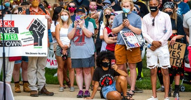 Demonstrators listen to Amrita Chakrabarti Myers speak at the Monroe County courthouse, Monday, July 6, 2020, in Bloomington, Ind., in response to the attack on Vauhxx Booker.