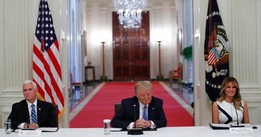 """President Donald Trump, Vice President Mike Pence, left, and first lady Melania Trump, attend a """"National Dialogue on Safely Reopening America's Schools,"""" event in the East Room of the White House, Tuesday, July 7, 2020, in Washington."""