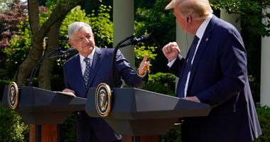 President Donald Trump and Mexican President Andres Manuel Lopez Obrador gesture before signing a joint declaration at the White House, Wednesday, July 8, 2020, in Washington.