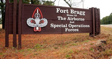 FILE - In this Jan. 4, 2020, file photo a sign for at Fort Bragg, N.C., is shown. A female soldier has graduated from the Army's elite Special Forces course and will for the first time join one of the all-male Green Beret teams. (