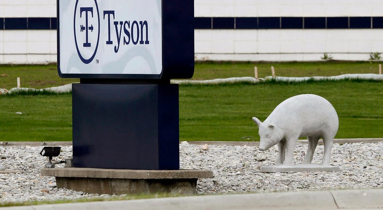 In this May 1, 2020, file photo, a sign sits in front of the Tyson Foods plant in Waterloo, Iowa.