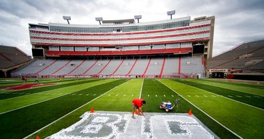 FILE - In this Thursday, Oct. 6, 2011 file photo, Turf manager Jared Hertzel touches up the newly-painted Big Ten conference logo on the football field at Memorial Stadium in Lincoln, Neb.