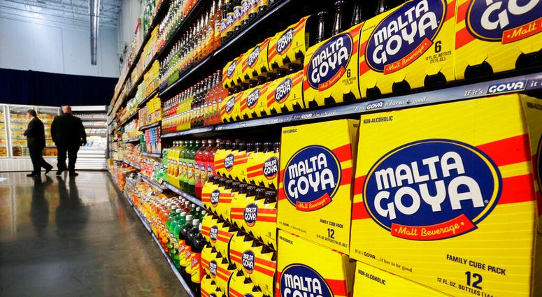 FILE - In this April 29, 2015, file photo, people walk past displays of Goya Foods products at the new corporate headquarters in Jersey City, N.J.