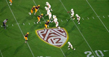 FILE - This Thursday, Aug. 29, 2019, file photo, shows the Pac-12 logo during the second half of an NCAA college football game between Arizona State and Kent State, in Tempe, Ariz.